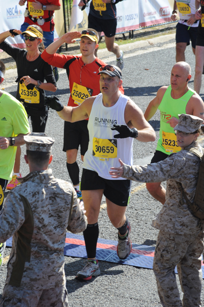 Saluting the Marines as we crossed the (crowded) finish line