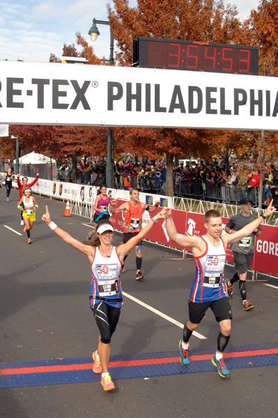 Crossing the finish in our 50 States Marathon club vests